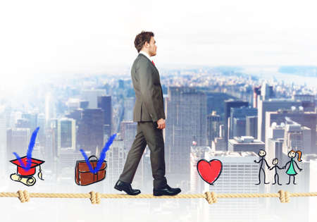 attain: Successful businessman walking on a life rope Stock Photo