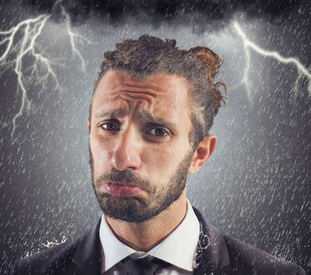 Portrait of sad businessman with storm background Stock Photo