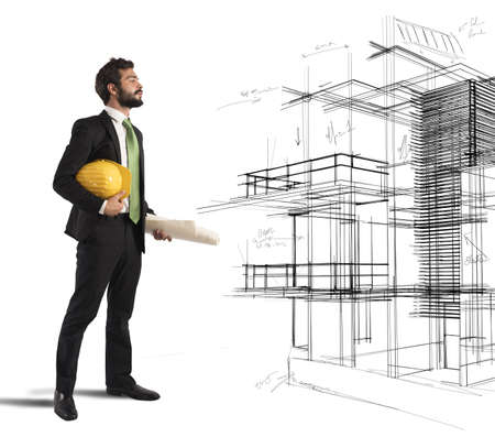 contractor: Young architect imagines his new construction project Stock Photo