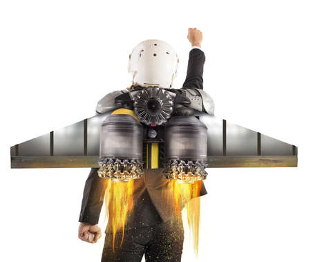 Man with helmet flies with powerful turbine