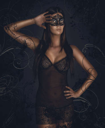 erotic fantasy: Sensual woman in underwear with black mask