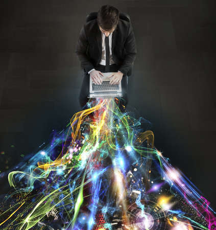 Man sitting with laptop and light beams Stok Fotoğraf