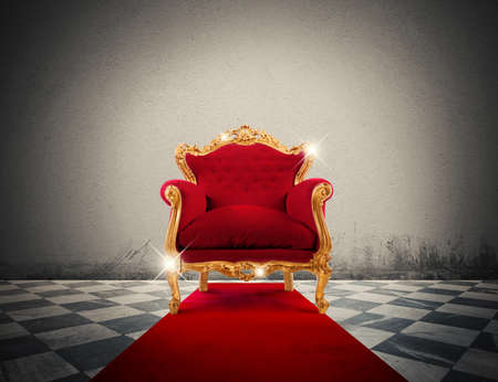 royalty: Sparkling golden armchair in a red carpet