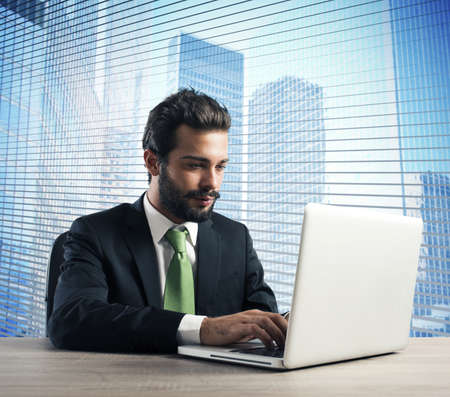 businessman in office: Businessman working in his office with laptop