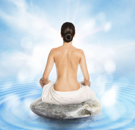naked woman: Woman doing yoga sitting on a stone
