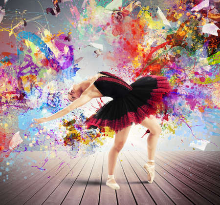Classical dancer posing between splashes of color Stock Photo