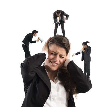 discredit: Employees yelling to a businesswoman with megaphone