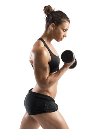 potency: Gym woman train her biceps with dumbbells