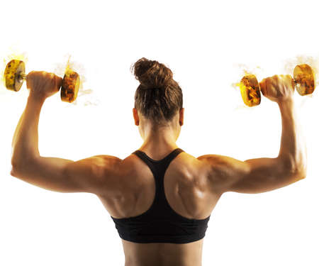 woman muscle: Gym woman train back with fiery dumbbells Stock Photo