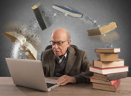 Elderly man with computer and books flying