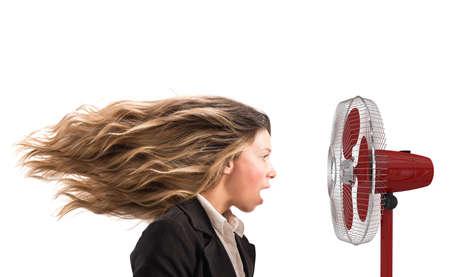 The air fan moves the woman hair