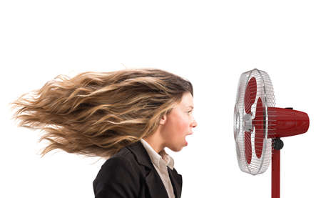 moves: The air fan moves the woman hair
