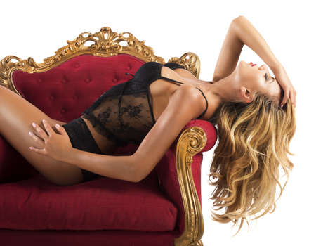 sex pose: Girl in underwear posing in an armchair