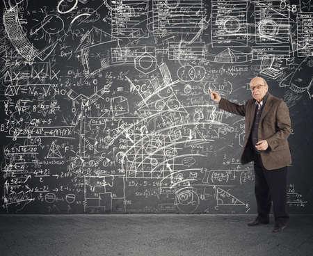 Genius aged teacher explains a complicated lesson