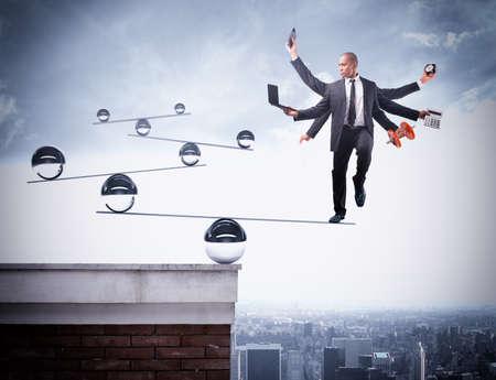 Businessman balancing on boards with iron balls Foto de archivo