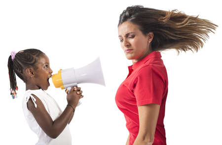 teen girl face: Child screaming with megaphone to an adult Stock Photo