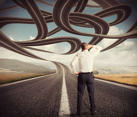 Confused undecided businessman watches the complicated road