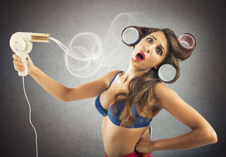 drier: Brunette pin-up girl dries her long hair