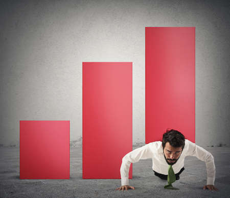 raises: Businessman raises a statistic with a bending Stock Photo
