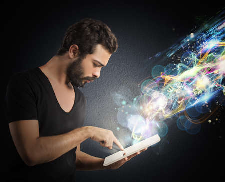 Boy with tablet that emits lighting effects