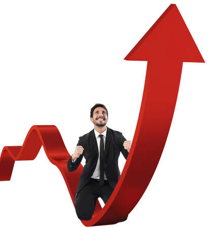 uphill: Businessman exults over a red uphill arrow