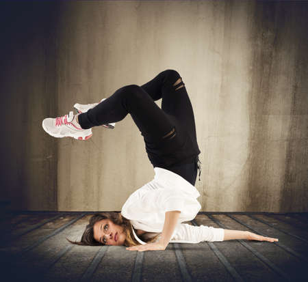 stunts: Agile dancer in a pose of breakdance Stock Photo