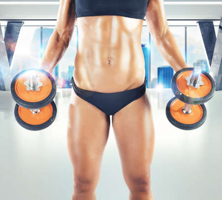 thong woman: Muscular woman is training in a gym