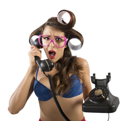 disgusted: Girl disgusted and astonished on the phone Stock Photo