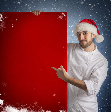 Chef shows a red billboard of christmas