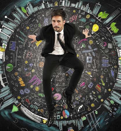 Marketing Strategy: Businessman sitting on a circle of symbols Stock Photo