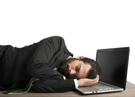 workload: Businessman workload falls asleep tired on computer Stock Photo