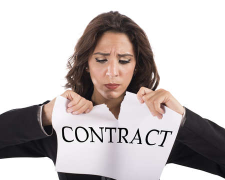 frustrate: Annoyed businesswoman tears the document work contract Stock Photo