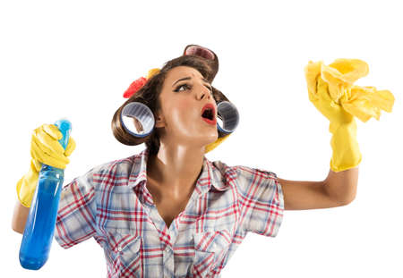 retro housewife: Vintage housewife cleans with spray and cloth