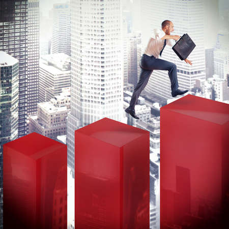 rise to the top: Businessman runs and jumps on a statistic