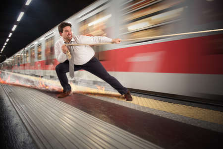 tries: Man tries to stop the fast train Stock Photo