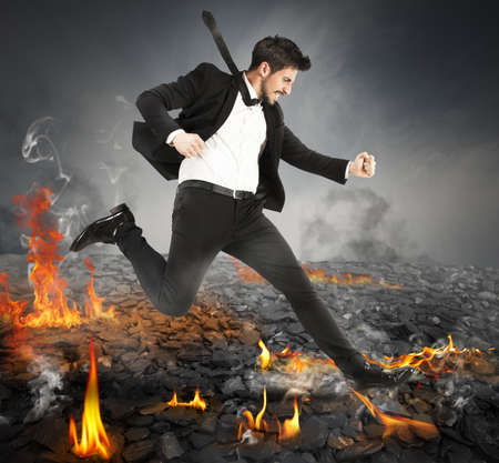 quickly: Determined businessman runs quickly on hot coals Stock Photo