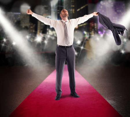 exult: Winner businessman rejoices on a red carpet