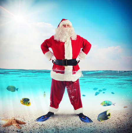swimming costumes: Man dressed as Santa Claus with fins Stock Photo
