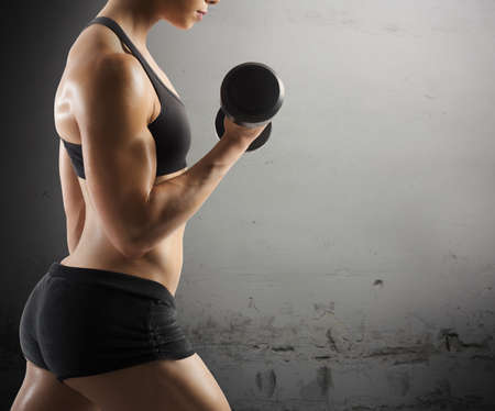workout: Athletic muscular woman workout with grunge background Stock Photo