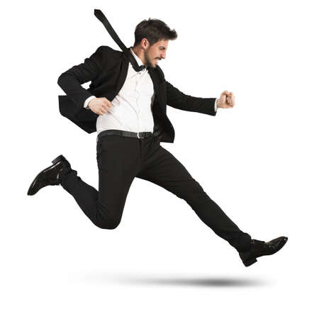 runs: Determined businessman with the suit quickly runs Stock Photo