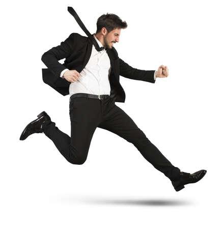 punctuality: Hombre de negocios resuelto con el traje se queda r�pidamente Foto de archivo