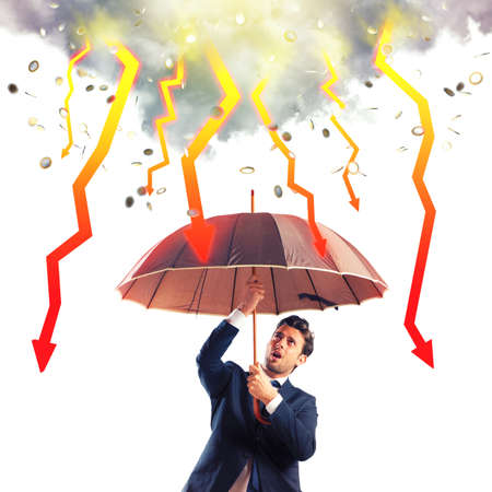 down arrow: Businessman sheltered with umbrella from lightning arrow
