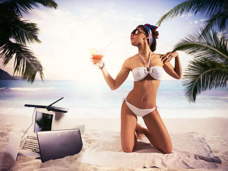 computer office: Businesswoman on summer vacation drinking a drink