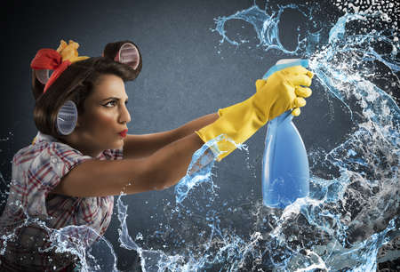 homemaker: Housewife cleans determined with much cleaner spray