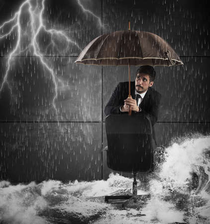 Frightened man protects himself with an umbrella