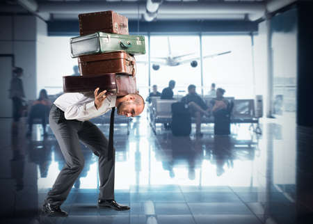 Businessman with so many suitcases inside airport