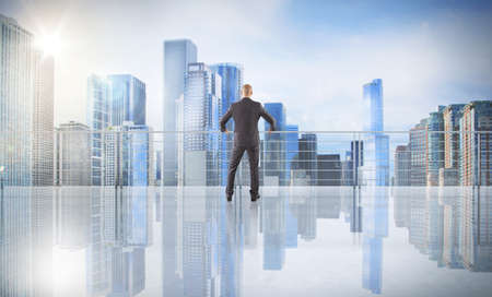 corporate building: Businessman looks at the city from above Stock Photo