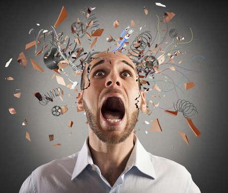 agression: Stressed businessman with broken mechanism head screams