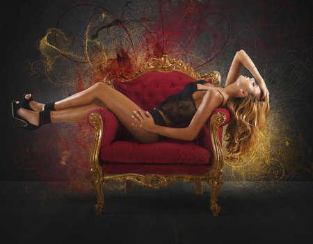 sex pose: Sensual woman lying on an armchair baroque
