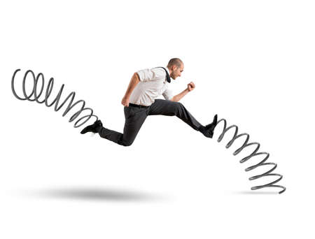 businessman running: Businessman running fast with the big springs